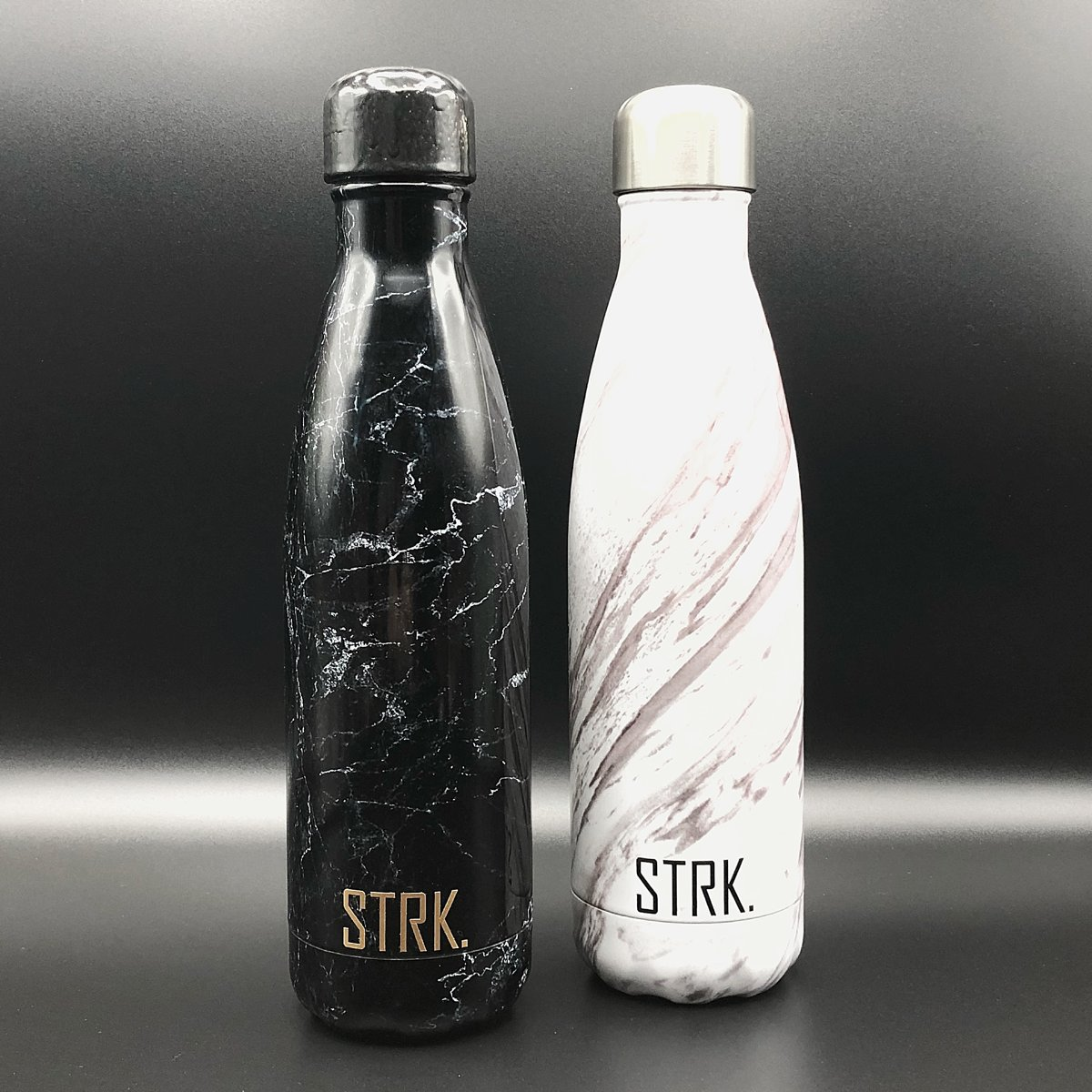 Carrara marble/ black marble travel bottles by STRK